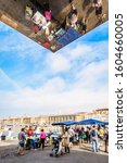 Small photo of Marseille, France - May 24, 2018: Tourists and people of Marseille shopping and strolling on the fish market of the Old Port next to the Ombriere, the large mirrored sunshade by Norman Foster.