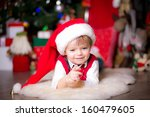 happy boy in a christmas hat... | Shutterstock . vector #160479605
