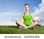 young woman meditating outdoors   Shutterstock . vector #160502306