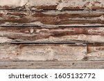 Wall Of Wooden Planks Worn By...