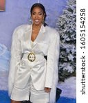 "Small photo of a_Kelly Rowland 138 attends the premiere of Sony Pictures' ""Jumanji: The Next Level"" at TCL Chinese Theatre on December 09, 2019 in Hollywood, California"