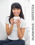 calm beautiful woman holding a... | Shutterstock . vector #160531316