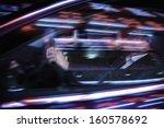 businessman driving at night