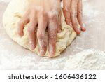 Small photo of Fingers knead holiday dough on a flour-sprinkled table, Russia