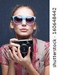 trendy girl in glasses playing... | Shutterstock . vector #160648442