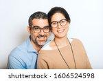 Studio Portrait Of Happy Couple ...
