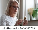 Mature Woman In Glasses Hold...