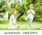mother and son doing yoga... | Shutterstock . vector #160670912