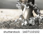 Closeup photo of hole drilling process, metal shavings around drill. Blurred background - stock photo