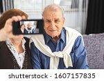 senior couple makes selfie... | Shutterstock . vector #1607157835