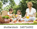 mother having picnic with her... | Shutterstock . vector #160716302