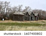 Three Old Abandoned Wooden...