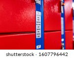 "Small photo of Text posted on a red metal locker read ""US quarters only"" and ""First quarter will drop, last quarter will activate the lock"""