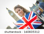 Young Woman Holding Union Jack...