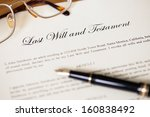 Small photo of Last will and testament with pen and glasses concept for legal document