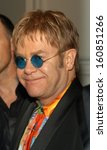 Small photo of Elton John arrives at the Rainforest Foundation Benefit Concert afterparty April 21, 2004 at The Pierre hotel in New York City