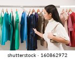 woman in clothes shop | Shutterstock . vector #160862972