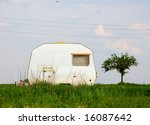 Camping trailer on a meadow - stock photo