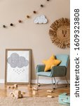 Small photo of Modern scandinavian newborn baby room with mock up photo frame, mint armchair, wooden car, plush animal and clouds. Hanging cotton balls and star. Cozy kid room interior with beige walls. Home staging