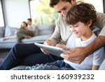 father and son playing with... | Shutterstock . vector #160939232
