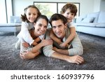 family at home relaxing on... | Shutterstock . vector #160939796