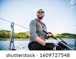 Fisherman Holding Small Motor...
