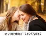 two young females sitting... | Shutterstock . vector #160972862
