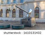 Small photo of Oslo, Norway, 12.11.2019. Monument in the form of a steel hammer crushing a fascist swastika on the station square in Oslo