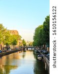 Small photo of Amsterdam, Netherlands - June 30, 2019: Canal (street) Herengracht. The historic city center. Old town houses