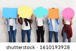 Small photo of Everyone has own opinion. Teens holding empty colourful speech bubbles