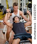 personal trainer helping young... | Shutterstock . vector #161023592