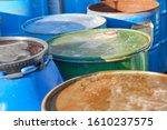 rusty metal barrels stacked in... | Shutterstock . vector #1610237575