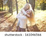 young happy mother with her... | Shutterstock . vector #161046566