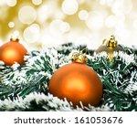 Orange christmas ornament ball against yellow bokeh background - stock photo