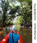 Small photo of woman sit on the boat in canal,Little Amazon Phang Nga (Klong Sang Nae), Phang Nga, Thailand.Ancient banyan forest Thailand