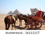 horses in front of pyramide of...   Shutterstock . vector #16111117