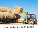 Tractor Loading Hay Bales On...