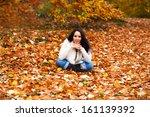 beautiful woman in a park in... | Shutterstock . vector #161139392