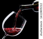 Red Wine Is Poured Into A Wine...