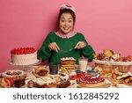 Cheerful Mixed Race Woman Eats...