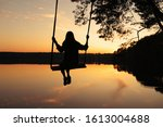 Romantic Young Woman On A Swing ...