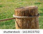 A Big Rope Tied Around A Wooden ...