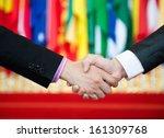 Businessmen Shaking Hands In...