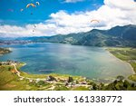 Paraglider Flying Over The ...