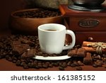 cup of coffee  grinder and... | Shutterstock . vector #161385152