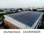Small photo of Aerial photo of solar panels on roof of one of the big building in the city, solar panels absorb sunlight as a source of energy to generate electricity creating sustainable energy.