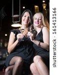 two beautiful elegant women... | Shutterstock . vector #161413166
