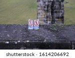 """Small photo of Chirk, Denbighshire, Wales, UK. January 9, 2020. A """"don't walk"""" safety warning sign high on the edge of Chirk aqueduct."""