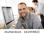 cheerful guy sitting in front... | Shutterstock . vector #161444822