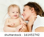 happy mother with baby | Shutterstock . vector #161452742